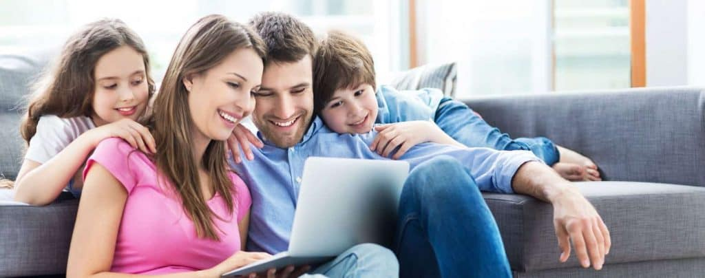a family watching something on the laptop